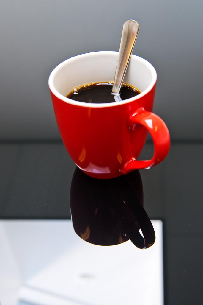 Cup of coffee on a glass table